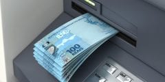 cash coming out of an ATm machine