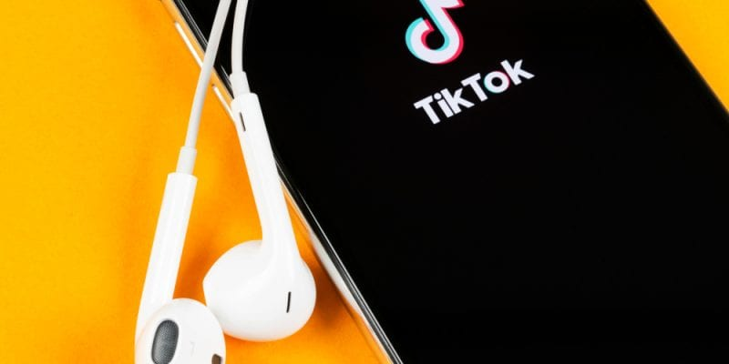 Video sharing social media TikTok logo on smartphone screen