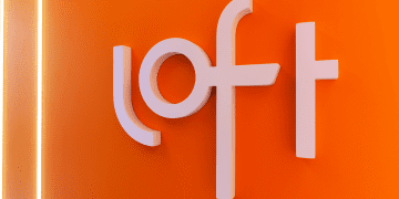 The brand of the Brazilian startup Loft on a wall