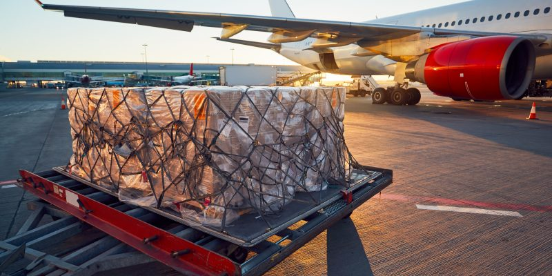 Cargo being loaded onto a passenger airplane