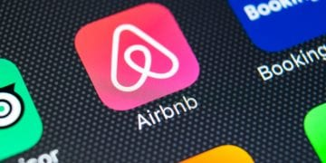 home rental Airbnb app icon on a smartphone screen