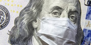 a 100 dollar money bill with face mask