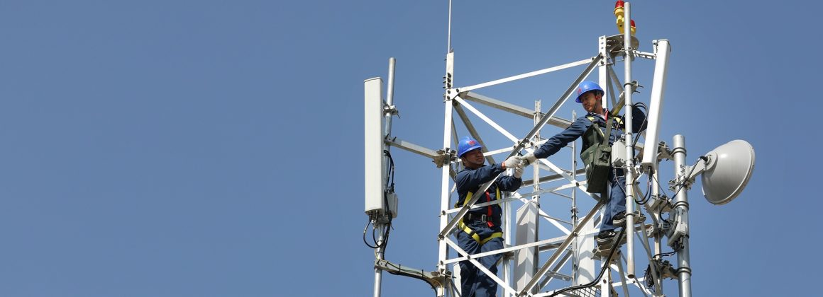 Workers work on the maintenance of Huawei's antennas